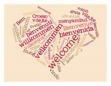 Sydän, jossa on eri kielillä sanottu Tervetuloa.